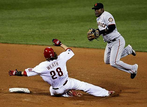 The Phillies' Jayson Werth breaks up a double play in front of the Giants' Juan Uribe in Game 1 of the NLCS at Citizens Bank Park in Philadelphia on Saturday. Photo: Lance Iversen, The Chronicle
