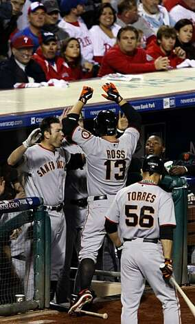 Cody Ross is greeted at the Giants dugout after hitting a solo home run in the third inning of Game 1 of the NLCS at Citizens Bank Park in Philadelphia on Saturday. Photo: Lance Iversen, The Chronicle