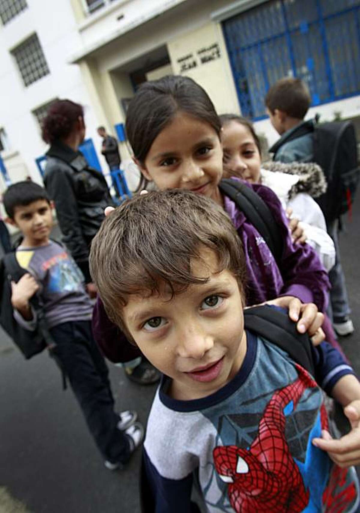 ** ADVANCE FOR USE SUNDAY, OCT. 10, 2010 AND THEREAFTER ** Unidentified Roma children leave school in Choisy-le-Roi, France, south of Paris, on Friday, Sept. 24, 2010. For Europe's 10 to 12 million Roma, as Gypsies are also known, a central factor in their impoverishment is poor access to education, with problems ranging from late starts to early dropouts, from segregated schools in Eastern Europe to the systematic misdiagnosis of mental disabilities.