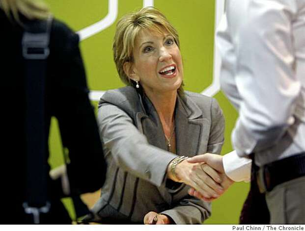 "Former HP CEO Carly Fiorina autographs copies of her book, ""Tough Choices"", after her speech at the Pacific Coast Builders Conference in San Francisco, Calif., on Wednesday, June 25, 2008. Photo by Paul Chinn / The Chronicle Photo: Paul Chinn, The Chronicle"