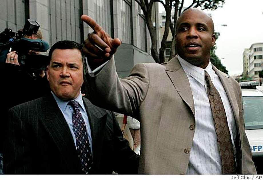 Former San Francisco Giants baseball player Barry Bonds, right, walks to his car after leaving the federal courthouse in San Francisco, Thursday, Jan. 5, 2009. Bonds is charged with lying to a December 2003 grand jury when he said he never knowingly used performance-enhancing drugs. He pleaded not guilty to the charges earlier Thursday.  (AP Photo/Jeff Chiu) Photo: Jeff Chiu, AP / ONLINE_CHECK