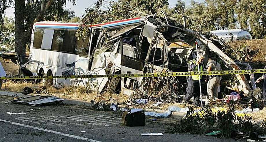 FILE - In this July 22, 2010 file photo, California Highway Patrol officers investigate a Greyhound bus crash on Highway 99 in Fresno, Calif., that killed 6 people and injured many others. The teen SUV driver who triggered the fatal  bus crash was legallydrunk when her Chevrolet Trailblazer rolled over on Highway 99 in the path of the bus, authorities said. Photo: Gary Kazanjian, AP