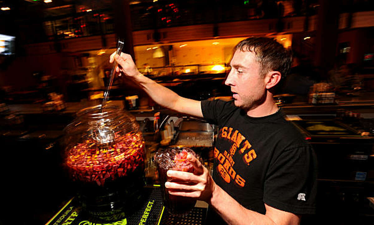 Hal Coleman, a bartender at Pedro's Cantina, fixes a pitcher of sangria on Thursday, Oct. 14, 2010, in San Francisco.