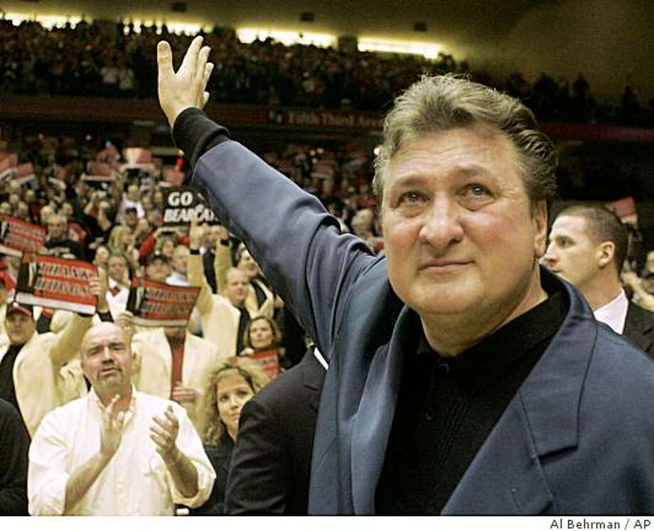 West Virginia head coach Bob Huggins waves to the crowd during a ceremony honoring Huggins prior to the start of an NCAA college basketball game against Cincinnati, Thursday, Feb. 26, 2009, in Cincinnati. This was his first game back to Cincinnati since leaving as head coach. Huggins had coached 16 years in Cincinnati.  (AP Photo/Al Behrman) Photo: Al Behrman, AP