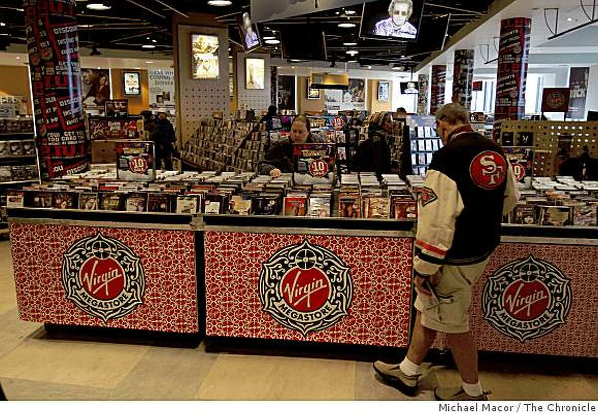 As shoppers browse bins of movies the company has announced plans to close the Virgin Megastore on Market Street in San Francisco, Calif., on Wednesday Feb. 26, 2009.