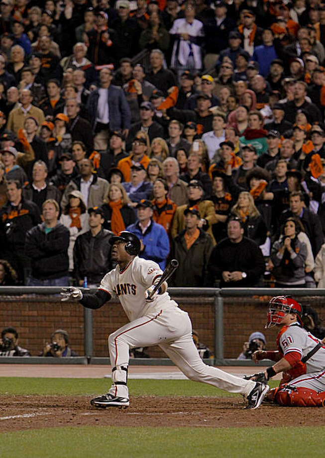 Giants Juan Uribe watches his deep fly ball in the bottom of the ninth inning that scored Aubrey HUff for the win, as the San Francisco Giants beat the Philadelphia Phillies 6-5, to take game 4 of the National League Championship Series,  on Wednesday Oct. 20, 2010 at AT&T Park, in San Francisco, Calif. Photo: Michael Macor, The Chronicle