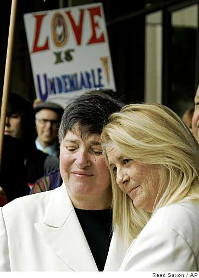 Robin Tyler, left, and Diane Olson, original plaintiffs in the California Supreme Court marriage equality suit, embrace as they repeat their marriage vows outside the Beverly Hills, Calif., courthouse Friday, Feb. 13, 2009. They are also plaintiffs in the current lawsuit to overturn Proposition 8, the California ballot measure that disallowed same-sex unions in the election last November.  (AP Photo/Reed Saxon) Photo: Reed Saxon, AP