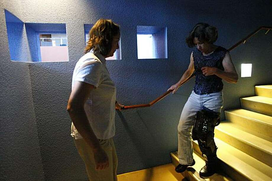 Physical trainer Erica Pitsch (left) assists patient Micha Hoy to walk up and down the stairs while Hoy wears the Tibion Bionic Leg at the Bakar Fitness & Recreation Center at UCSF Mission Bay Campus in San Francisco, Calif., on Oct. 14, 2010. Photo: Michelle Gachet, The Chronicle