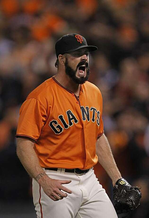 Giants pitcher Brian Wilson reacts as he closes out the 8th inning, as the San Francisco Giants battle the Atlanta Braves in game 2 of the National League Division Series at AT&T Park  on Friday Oct. 8, 2010, in San Francisco, Calif., Photo: Michael Macor, The Chronicle