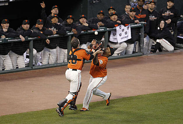 Giants Buster Posey, left, and Pablo Sandoval collide while chasing a pop fly hit by Braves Jason Heyward in the top of the first inning as the San Francisco Giants take on the Atlanta Braves  in Game 2 of the National League Division Series at AT&T Park in San Francisco, Calif., on Friday, October 8, 2010. Photo: Paul Chinn, The Chronicle