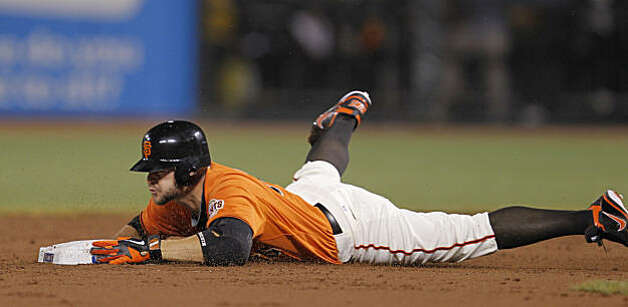 Giants Cody Ross slides into second base after hitting a double in the second inning as the San Francisco Giants take on the Atlanta Braves  in Game 2 of the National League Division Series at AT&T Park in San Francisco, Calif., on Friday, October 8, 2010. Photo: Michael Macor, The Chronicle