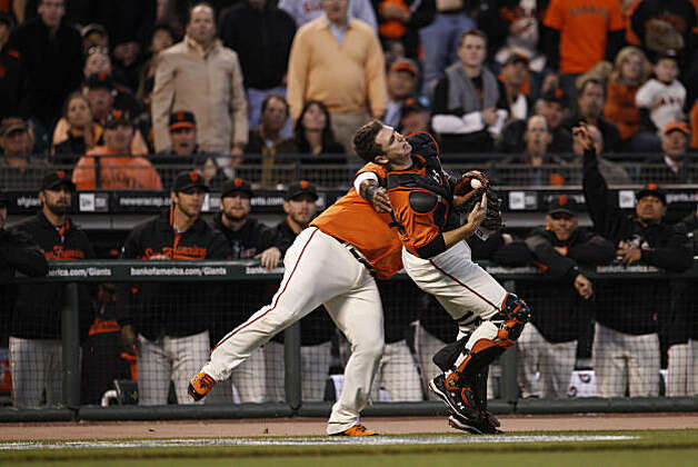 Giants Buster Posey, left, and Pablo Sandoval collide while chasing a pop fly hit by Braves Jason Heyward in the top of the first inning as the San Francisco Giants take on the Atlanta Braves  in Game 2 of the National League Division Series at AT&T Park in San Francisco, Calif., on Friday, October 8, 2010. Posey caught and held the ball for the out. Photo: Carlos Avila Gonzalez, The Chronicle