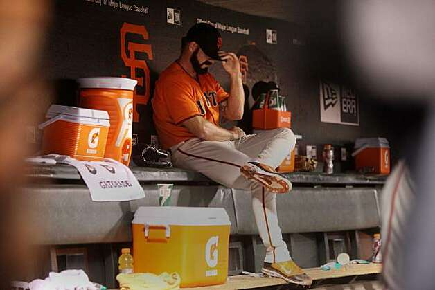 Giants Pitcher Brian Wilson holds his head down in the dugout at the end of the 8th inning of the Giants playoff game against the Atlanta Braves on Friday Oct. 7, 2010 in San Francisco, Calif. Photo: Mike Kepka, The Chronicle
