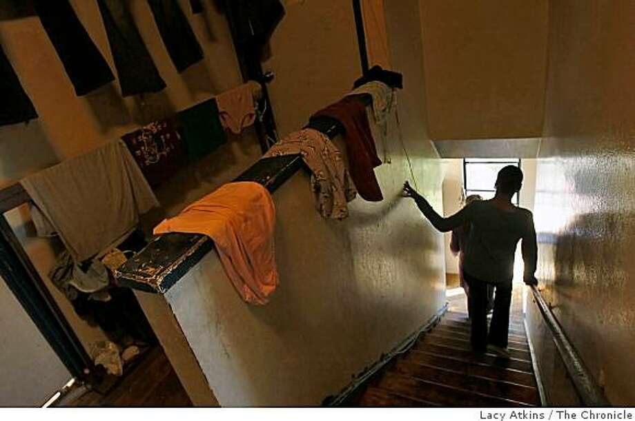 Tasha Brown walks down the stairs where her mother hangs their wet laundry at her apartment at Huntersview housing development, Wed. Jan. 7, 2009, in San Francisco, Calif.   They hang their laundry among the mold because the apartment lacks a working dryer. Photo: Lacy Atkins, The Chronicle