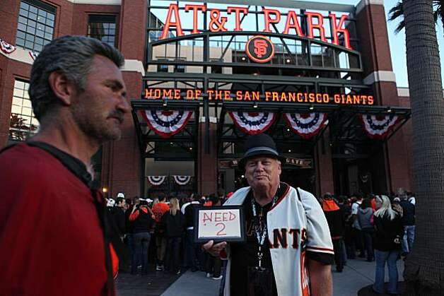 "Hoping to get in to AT&T park, Greg Drennan, of Folsom, Calif., holds and iPad that says ""Need 2"" before the start of the Giants playoff game against the Atlanta Braves on Friday Oct. 7, 2010 in San Francisco, Calif. Photo: Mike Kepka, The Chronicle"