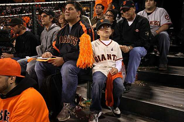 Len Girimonte, and his son Nick Girimonte, 7, of Windsor, Calif. keep score form the the center field bleachers in the 5th inning during the Giants playoff game against the Atlanta Braves on Friday Oct. 7, 2010 in San Francisco, Calif. Photo: Mike Kepka, The Chronicle