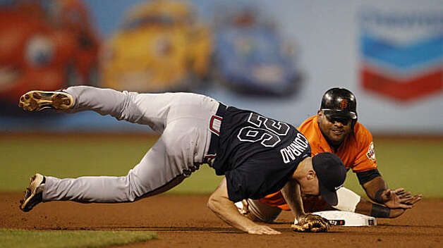Giants Pablo Sandoval takes out Brooks Conrad on a double play attempt in the seventh inning.  Cody Ross was save at first. The San Francisco Giants take on the Atlanta Braves  in Game 2 of the National League Division Series at AT&T Park in San Francisco, Calif., on Friday, October 8, 2010. Photo: Michael Macor, The Chronicle
