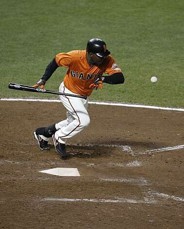 Giants Edgar Renteria leads out the bottom of the 10th inning with a pinch hit bunt for a single as the San Francisco Giants take on the Atlanta Braves  in Game 2 of the National League Division Series at AT&T Park in San Francisco, Calif., on Friday, October 8, 2010. Photo: Carlos Avila Gonzalez, The Chronicle
