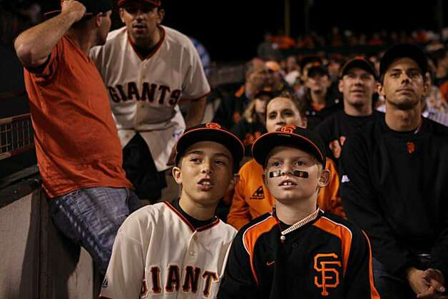 Ricky Pearce, 11, and Adam Brocett, 11, discuss 3rd inning action during the Giants playoff game against the Atlanta Braves on Friday Oct. 7, 2010 in San Francisco, Calif. Photo: Mike Kepka, The Chronicle