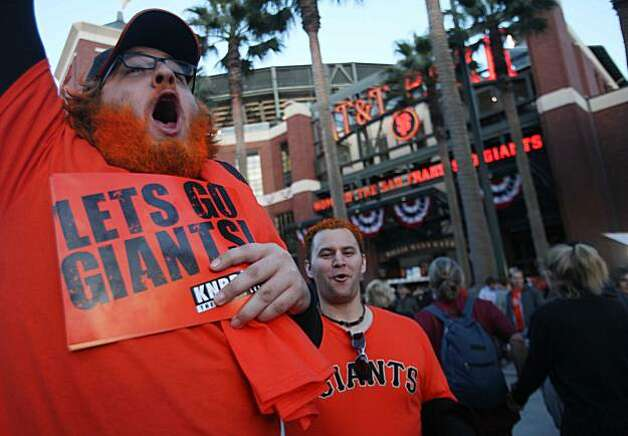 Logan Rockmore, of Cupertino, Calif., yells as he spots another orange haired friend in the crowd before heading into to see the Giants playoff game against the Atlanta Braves on Friday Oct. 7, 2010 in San Francisco, Calif. Photo: Mike Kepka, The Chronicle