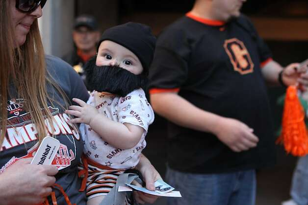"Nikki Peterson holds her bearded son, Dallas ""Rally Dallas"" Peterson, 7, months before heading into to see the Giants playoff game against the Atlanta Braves on Friday Oct. 7, 2010 in San Francisco, Calif. Photo: Mike Kepka, The Chronicle"
