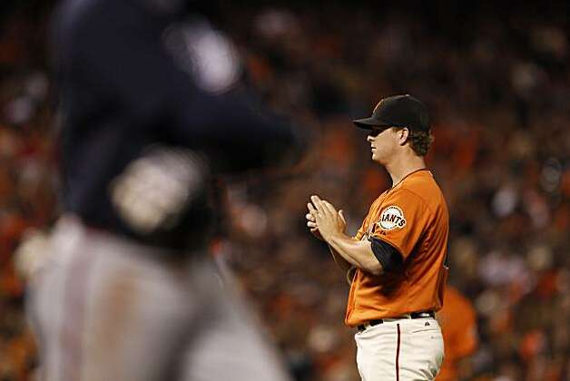 Giants pitcher Matt Cain walks Braves Omar Infante in the fifth inning as the San Francisco Giants take on the Atlanta Braves  in Game 2 of the National League Division Series at AT&T Park in San Francisco, Calif., on Friday, October 8, 2010. Photo: Carlos Avila Gonzalez, The Chronicle