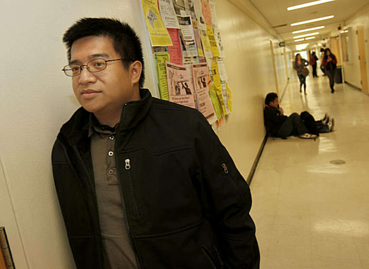 Bryan Guillermo waits in the hallway for a class in the HSS building on the SF State University campus. Bryan Guillermo took over four years to transfer from a junior college to San Francisco State University where he is a psychology major.