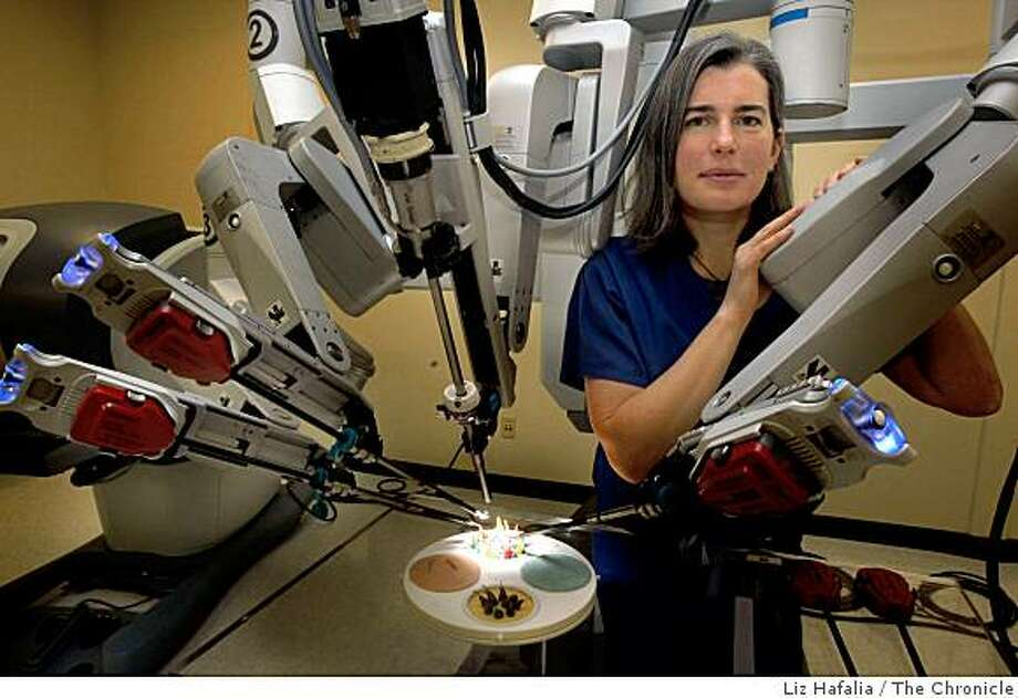 "Dr. Catherine Mohr of Stanford Medical School who works for ""Intuitive Surgical"" company, has developed a robotic arm to be used in difficult surgeries which she displays in Sunnyvale,  California, on Monday, February 23, 2009. Photo: Liz Hafalia, The Chronicle"