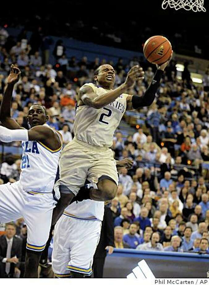 Washington's Isaiah Thomas (2) goes to the basket as UCLA's Jrue Holiday (21) defends during the first half of an NCAA college basketball game in Los Angeles Thursday, Feb. 19, 2009. UCLA won 85-76. (AP Photo/Phil McCarten) Photo: Phil McCarten, AP