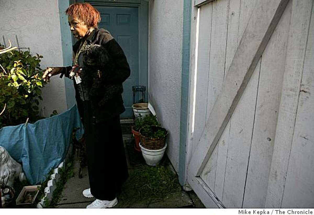 Rozena Jackson, a 32 year resident of Midway Village, stands outside her home in the housing complex on Tuesday Feb. 17, 2009 in Daly City, Calif. She and other residents say they have been dealing with several difficult issues there including health problem related to toxic waste buried below their homes.
