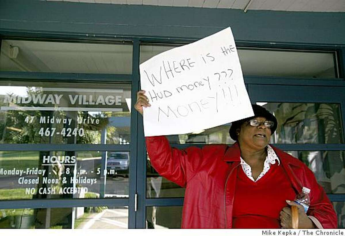 Frankie Rankins, a resident of Midway Village, protests outside the Housing Authority office in her neighborhood on Tuesday Feb. 17, 2009 in Daly City, Calif. She said she and other residents have been dealing for several difficult issues there including health problem related to toxic waste buried below their homes.