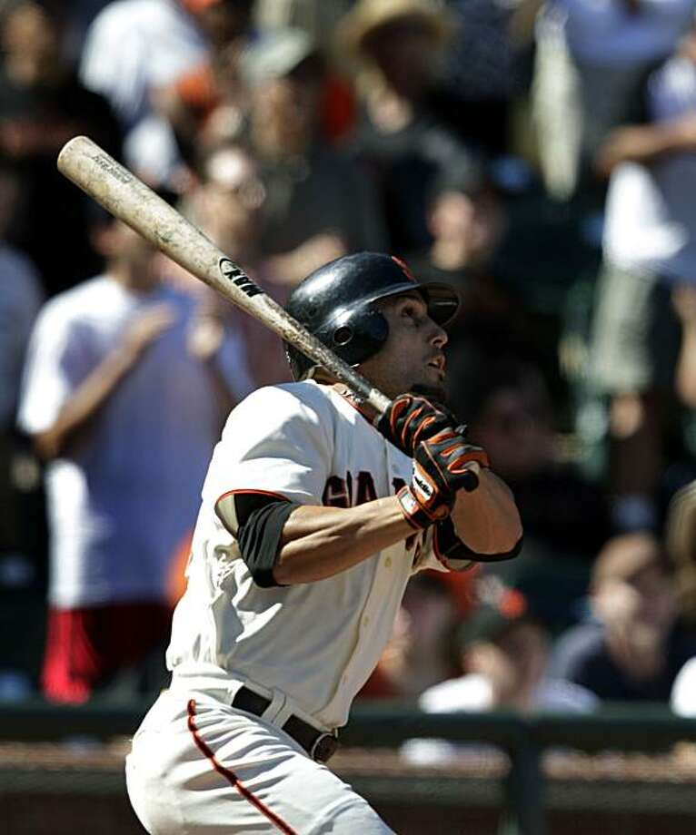 San Francisco Giants' Andres Torres follows the fight of his game winning single that allowed Aaron Rowand to score with the bases loaded in the 9th inning. The Giants won the four game series taking three of four at AT&T Park in San Francisco Thursday August 12, 2010. Photo: Lance Iversen, The Chronicle