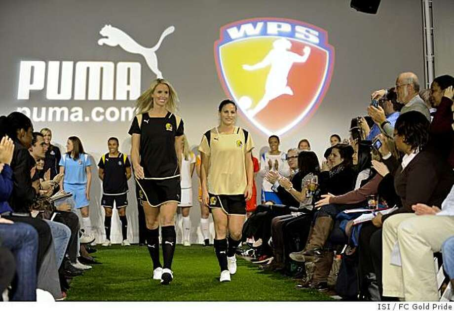 Leslie Osborne (left) and Tina DiMartino (right) in the FC Gold Pride Home (Black) and Away (gold) jerseys at the launch event at the W Hotel in Union Square (New York). Credit should be FC Gold Pride/ISI  At an exclusive event held in New York City, PUMA and the WPS unveiled team kits for all seven of the WPS? inaugural field of teams, including the new home and away jerseys of FC Gold Pride.The highly anticipated unveiling came on the heels of New York?s Fashion week which attracts the world?s elite to the Empire State, including Project Runway season four winner, Christian Siriano.  Siriano brought high fashion flare to the event, unveiling his own fashion interpretation of the Home and Away uniforms, creating two unique outfits inspired by the sport and team uniforms.FC Gold Pride will kick off the 2009 WPS season on April 5th at home against the Boston Breakers at Buck Shaw Stadium on the campus of Santa Clara University.  Season tickets, starting at only $100 for 10 regular season games are on sale now.  Call (408) 541-3511 or log on to fcgoldpride.com to reserve your seats. Photo: ISI, FC Gold Pride
