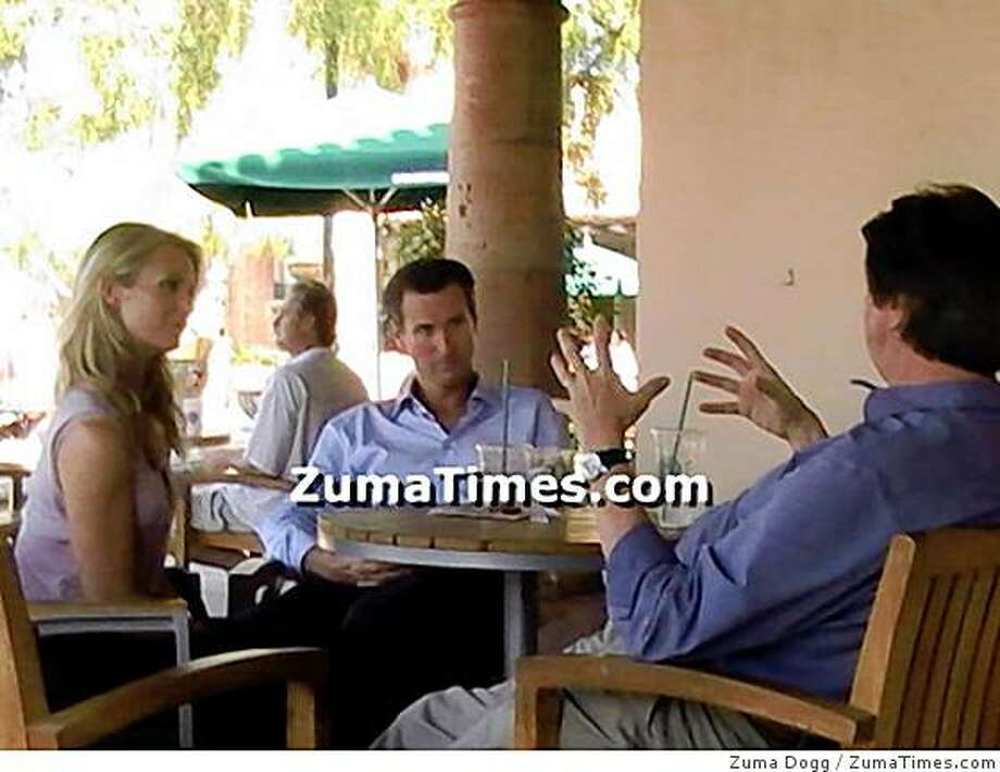 San Francisco Mayor Gavin Newsom and wife Jennifer Seibel Newsom talk with Democratic political consultant Garry South at a Starbucks in Malibu, Calif., on August 2, 2008. This picture, taken by L.os Angeles blogger Zuma Dogg, appeared on his blog and tipped off Newsom's run for governor. Photo: Zuma Dogg, ZumaTimes.com