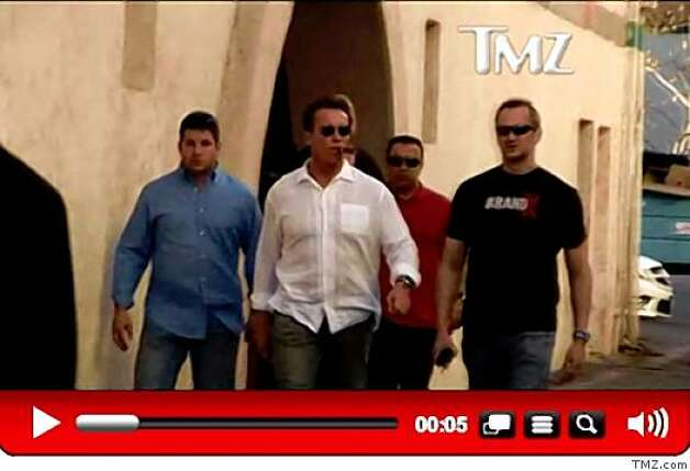 This screen capture from TMZ.com shows California Gov. Arnold Schwarzenegger with sunglasses and a cigar. The gossip-rich TMZ cable and Internet franchise has captured the governor more than 20 times. Photo: TMZ.com