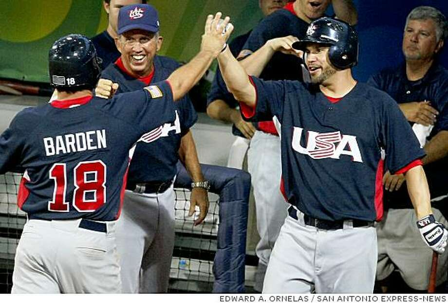FOR SPORTS - USA's Brian Barden celebrates with Manger Davey Johnson and John Gall after scoring agaisnt Japan during their preliminary game Wednesday Aug 20, 2008 in Beijing, China. Barden drove in the first run in the 11th inning and the USA went on to win 4-2. (PHOTO BY EDWARD A. ORNELAS/eornelas@express-news.net) Photo: EDWARD A. ORNELAS, SAN ANTONIO EXPRESS-NEWS