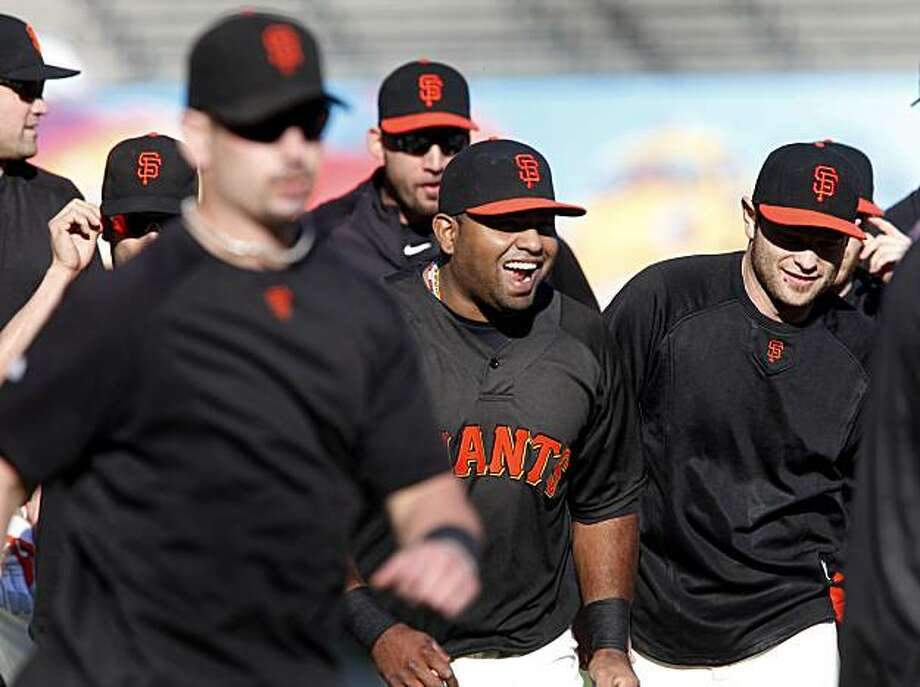 Pablo Sandoval (center) keeps things light during a running drill Monday at AT&T Park. Photo: Brant Ward, The Chronicle