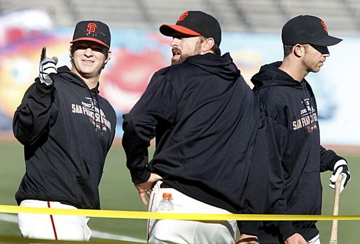 Matt Cain (left), Brian Wilson and Madison Bumgarner work out Monday at AT&T Park.