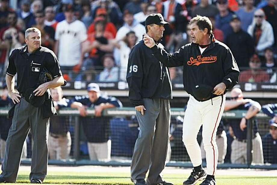 San Francisco Giants' manager Bruce Bochy agues a call late into their game with the San Diego Padres with umpire Tim McClelland who stepped in between Bochy and home plate umpire Mike Everitt. The Padres defeated the Giants 4-2 Saturday, Oct. 2, 2010, in San Francisco. Photo: Lance Iversen, The Chronicle