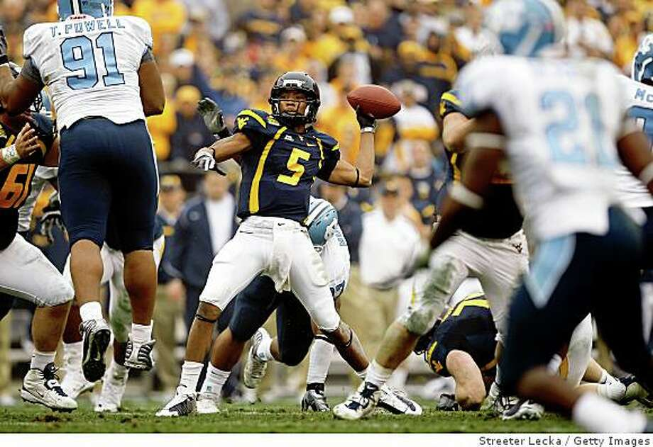 CHARLOTTE, NC - DECEMBER 27:  Pat White #5 of the West Virginia Mountaineers drops back to throw a pass against the North Carolina Tar Heels during the Meineke Car Care Bowl on December 27, 2008 at Bank of America Stadium in Charlotte, North Carolina.  (Photo by Streeter Lecka/Getty Images) Photo: Streeter Lecka, Getty Images