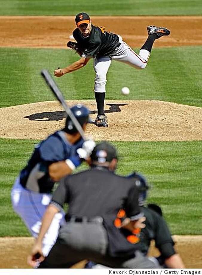 PEORIA, AZ - FEBRUARY 28:  Pitcher Barry Zito #75 of the San Francisco Giants follows through on a pitch against Franklin Gutierrez #21 of the Seattle Mariners during a spring training game at the Peoria Sports Complex on February 28, 2009 in Peoria, Arizona.  (Photo by Kevork Djansezian/Getty Images) Photo: Kevork Djansezian, Getty Images