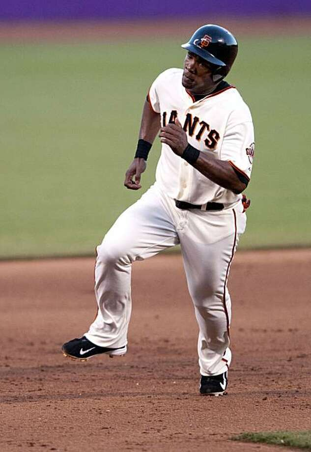 Jose Guillen sprints around 3rd base to score the Giants' first run as the San Francisco Giants take on the Colorado Rockies at AT&T Park in San Francisco, Calif., on Saturday, September 1, 2010. Photo: Chad Ziemendorf, The Chronicle