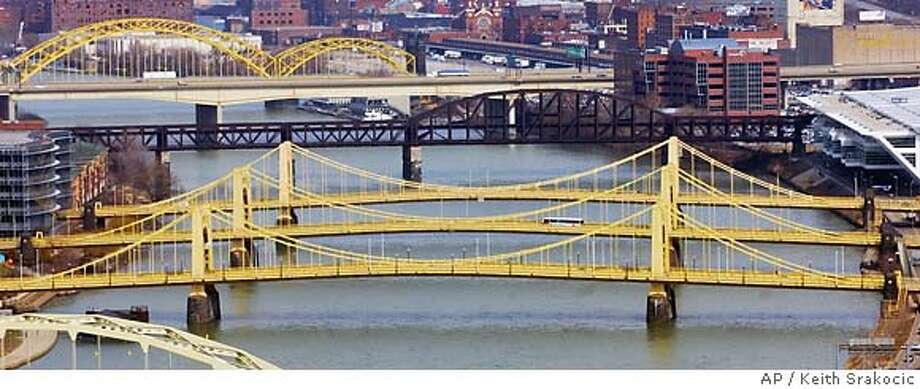 Among Pittsburgh's 446 bridges are the Three Sisters, the first self-anchored suspension bridges built in the United States. Associated Press photo, 2005, by Keith Srakocic