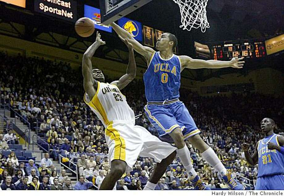 Cal Bears player Patrick Christopher (23), left, gets a shot blocked in the first half by UCLA Bruins player Drew Gordon (0), right, on Saturday, February 28, 2009, at Haas Pavilion in Berkeley, Calif. Cal led UCLA at the half  34-32. Photo: Hardy Wilson, The Chronicle