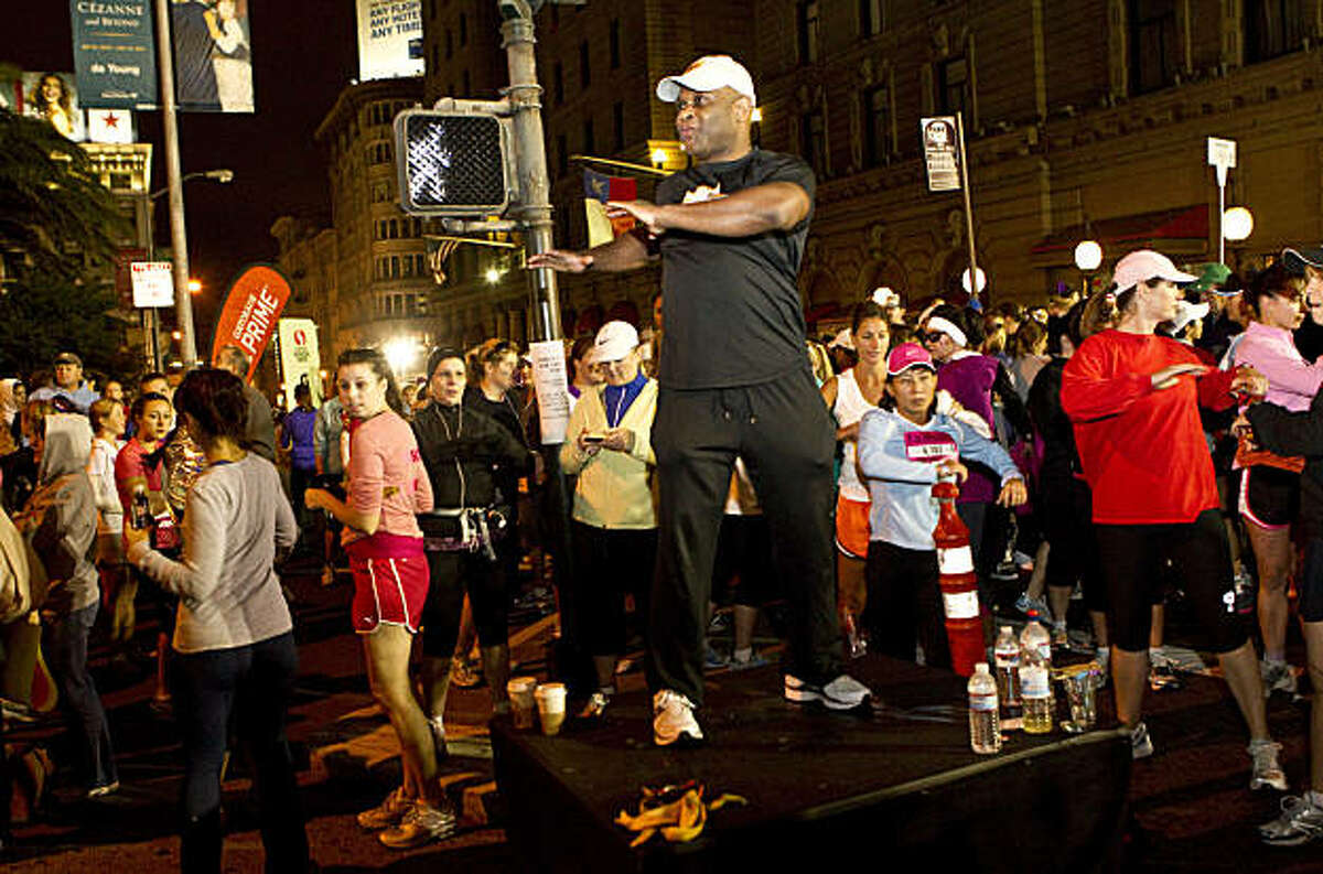 Andre Cravens leads participants of the Nike Women's Marathon in a warm-up exercise at the starting line in Union Square in San Francisco, Calif., on Sunday, October 17, 2010.