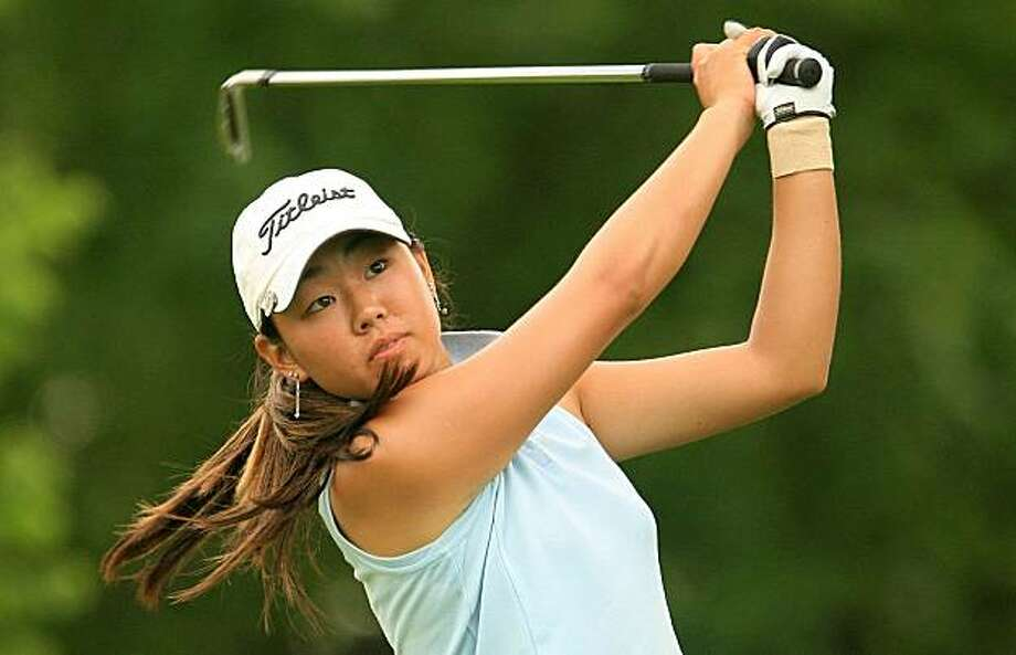 EDINA, MN - JUNE 26:  Amateur Mina Harigae hits her tee shot on the fourth hole during the first round of the 2008 U.S. Women's Open at Interlachen Country Club on June 26, 2008 in Edina, Minnesota.  (Photo by Scott Halleran/Getty Images) Photo: Scott Halleran, Getty Images