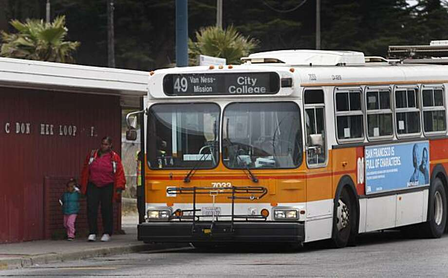 Passengers off load from a Muni bus at Ocean Avenue and Phelan Street in San Francisco, Calif., on Friday, July  30, 2010. A developer plans to build a 71-unit building on the property behind the bus stop but provide only five parking spaces. Photo: Paul Chinn, The Chronicle