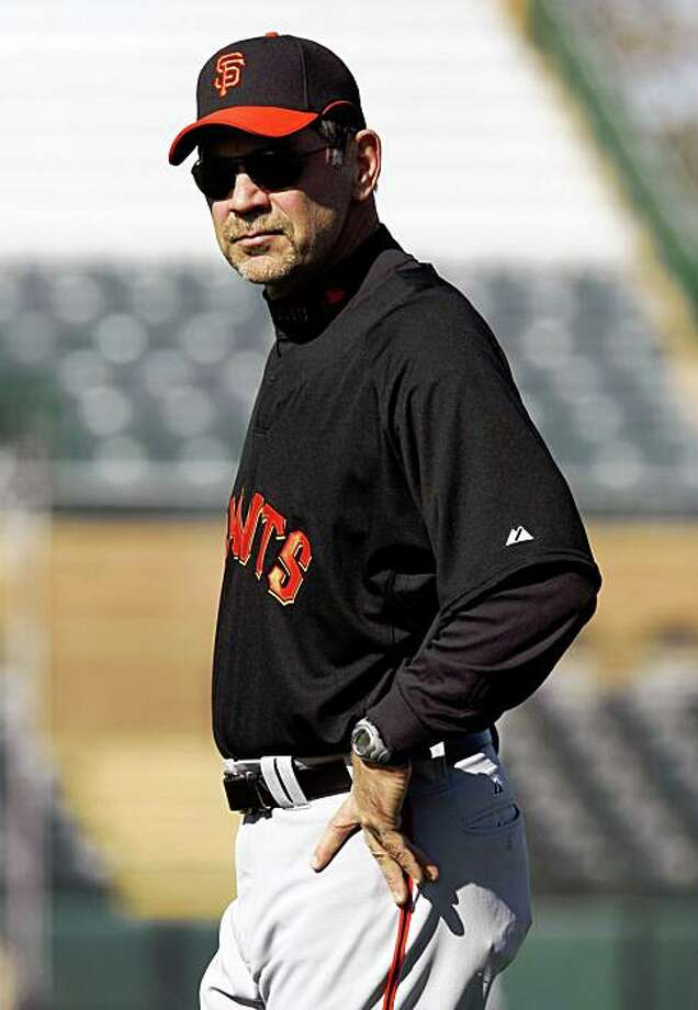 San Francisco Giants Manager Bruce Bochy walks the outfield during Spring Training workouts at Scottsdale Stadium Thursday February 19, 2009 in Scottsdale Arizona Photo: Lance Iversen, The Chronicle
