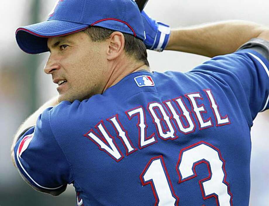 Former San Francisco Giant Omar Vizquel still wears the familiar number thirteen but now on a Texas Ranger uniform. Monday February 23, 2009 in Surprise Arizona Photo: Lance Iversen, The Chronicle