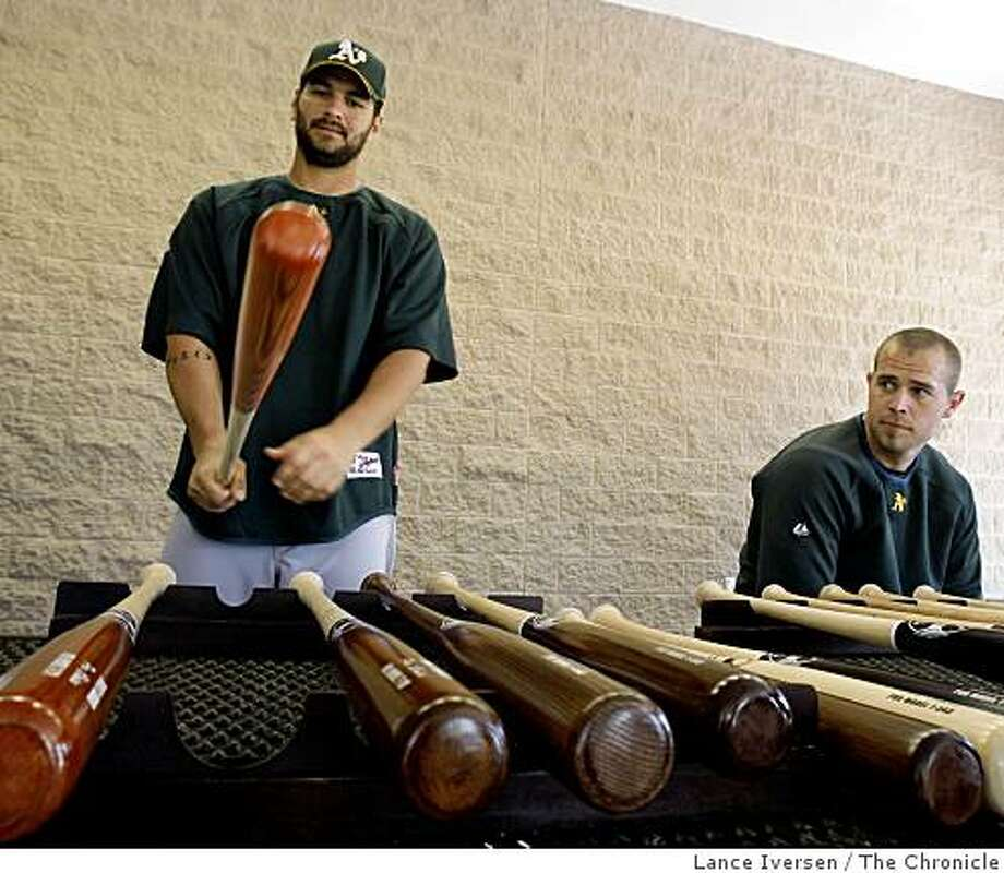 Oakland Athletics Eric Chavez and Bobby Crosby test drive custom bats by Trinity Bat Co, from Fullerton Ca outside the Spring Training club house at Papago Baseball Complex Frisday February 20, 2009 in Phoenix Arizona Photo: Lance Iversen, The Chronicle
